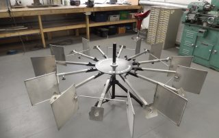 Portable carousel with baffle plates and medical arms